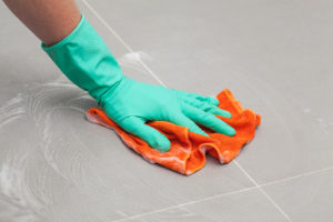 Image of hand cleaning floor